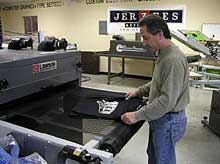 Cure the ink onto the t-shirt using a flash unit or conveyor dryer