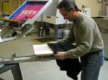 Load a t-shirt onto the platen